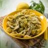 pasta with artichoke lemon peel and cilantro, selective focus