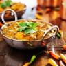 saag paneer curry dish with cilantro garnish