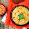 Red lentil vegetable soup on a dark wooden background. toning. selective focus