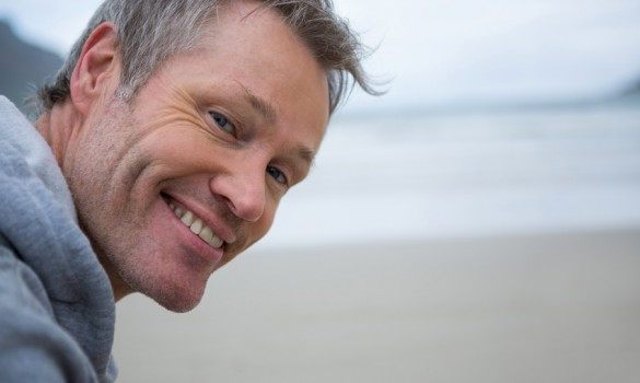 Close-up of happy man on beach